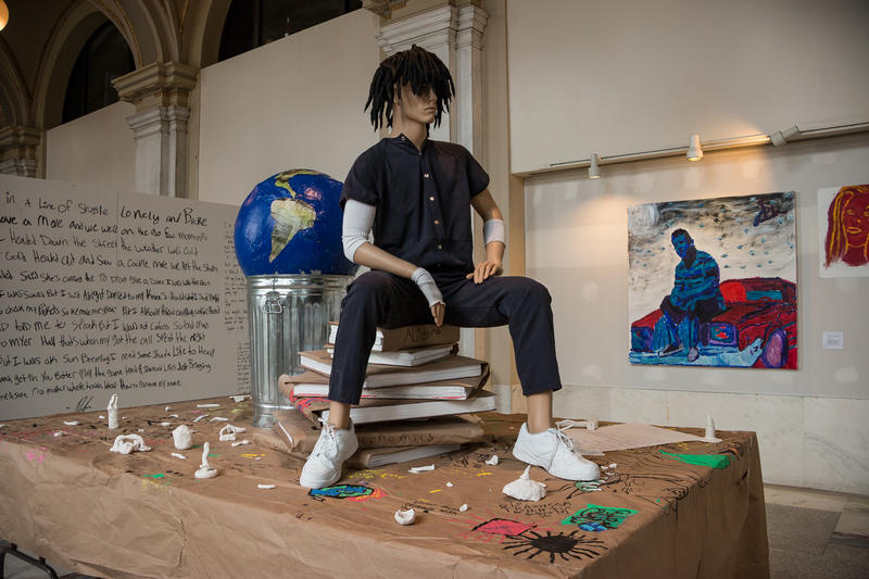 """""""The World In A Trash Can"""" is the centerpiece to the art exhibit """"Know Justice.""""  It was created by teenagers while in a detention center, guided by ArtForce Iowa mentors Saulaman Schiegel and Jordan Weber."""