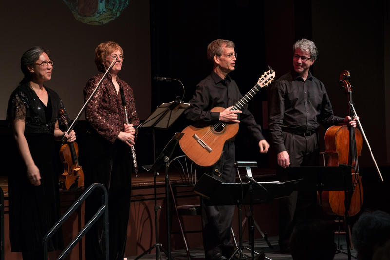 Mira Kim, Jan Boland, John Dowdall, Carey Bostian take a bow during Red Cedar Chamber Music's ensemble final performance of the season at C.S.P.S. hall in Cedar Rapids.