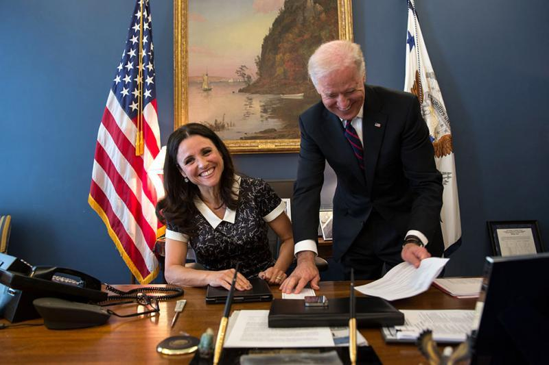 "Vice President Joe Biden jokes with Julia Louis-Dreyfus of the TV show, ""Veep,"" as she sits at his desk in the Vice President West Wing office at the White House, April 12, 2013"