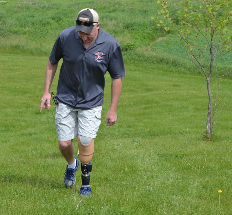 Jason Schroeder's new prosthetic leg has a flexing ankle that allows him to easily walk up inclines like this grassy hill.