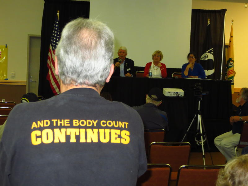 A veteran appears before Agent Orange symposium in Des Moines.