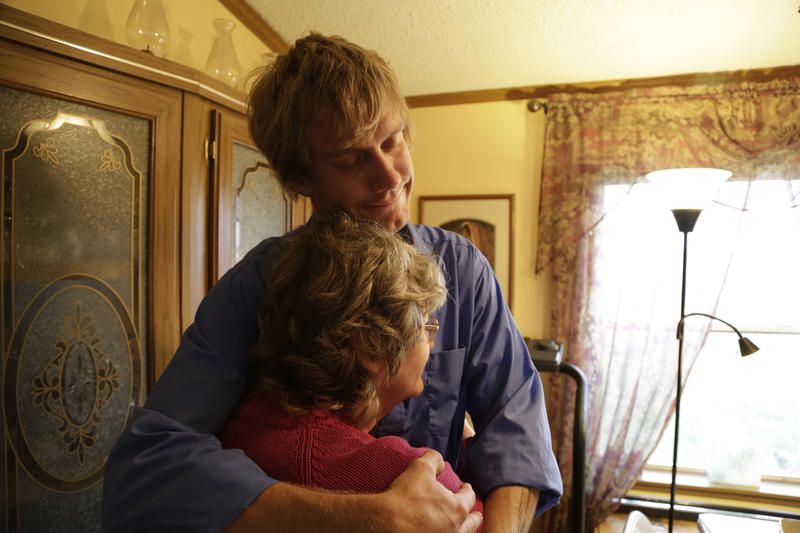 Tyson Horner hugs his mother Greta in their rural Larimer County, Colorado home.