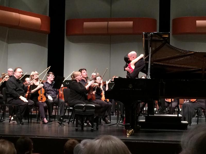 2nd Prize Winner Alison Lee of the U.S. hugs wcfsymphony conductor Jason Weinberger after her concerto performance