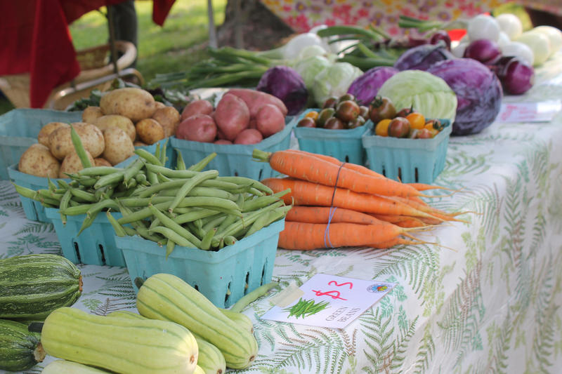 Produce is for sale at the LSI Global Greens Farmers Market in Des Moines in this 2014 file photo. Global Greens is participating in the Double Up Food Bucks incentive program.