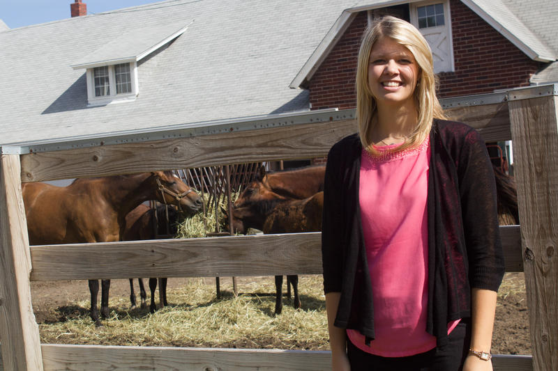 Haley Banwart, pictured at the Iowa State horse barn, brought a horse to her family's grain farm and she and her brother raised cattle. Banwart is working and getting a master's at Iowa State. Her brother plans to return home to farm after college.