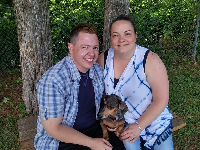 Transgender state employee Jesse Vroegh, wife Jackie, and dog Jazz