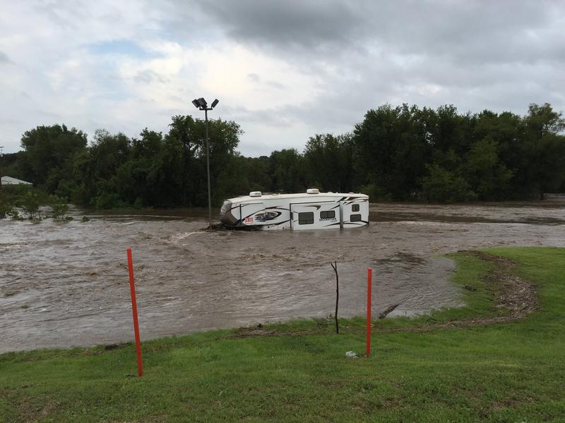 A camper is caught in flooding at the Highway 9 bridge near Decorah Chevrolet.