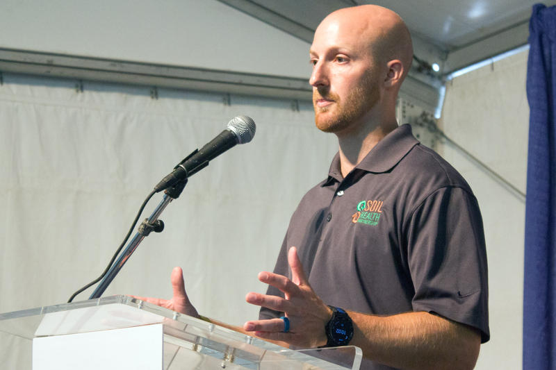 Soil Health Partnership director Nick Goeser speaks during the launch of the Midwest Row Crop Collaborative, which pledges to raise $4 million to support his program's work with on-farm conservation.