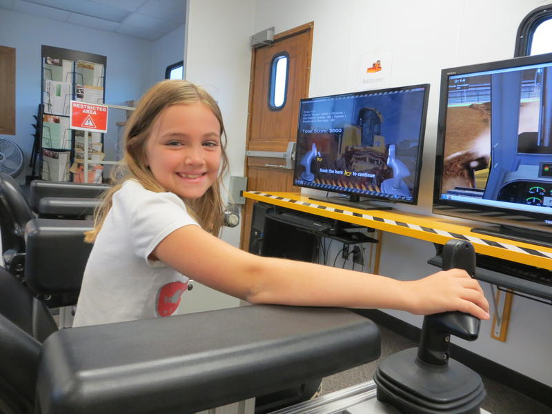 Nine year-old Allison Wallsteadt of Waterloo operates like a professional on the bulldozer screen