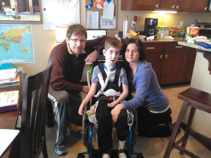 Chris, Carson and Brandy McDonough at their Cedar Rapids home