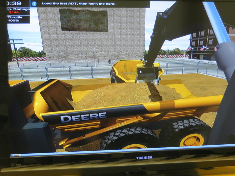 The construction equipment simulator offers six different stations including this one where operators load sand