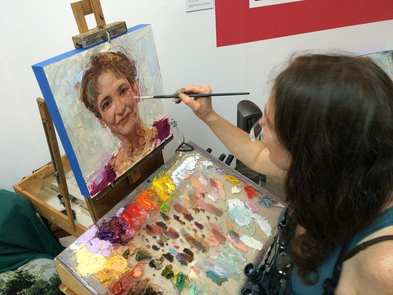 Rose Frantzen paints a portrait of Charity Nebbe at the Iowa State Fair