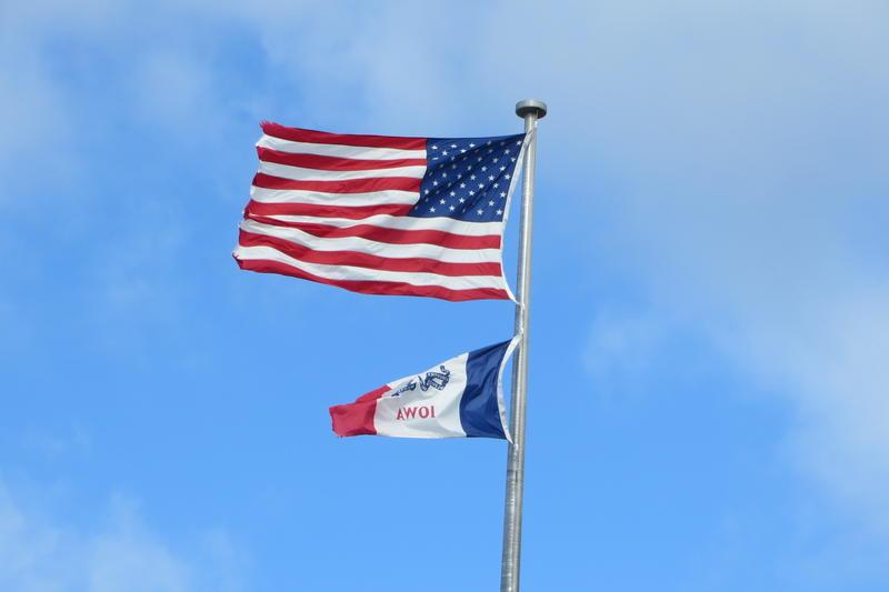 The main flag pole high atop the Iowa Capitol.