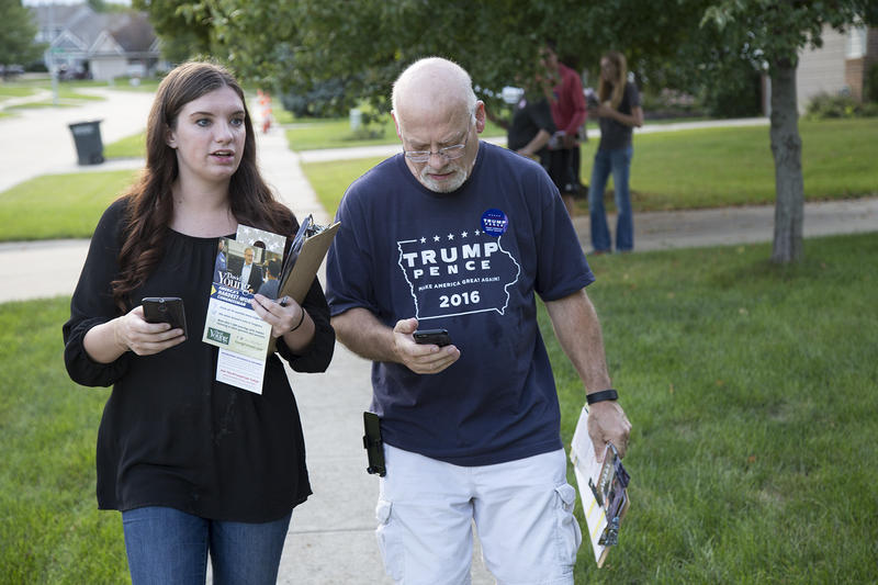Field Organizer Jillian Dunker and Iowa Republican Party volunteer Bill Simonis knock doors in Clive, Iowa.
