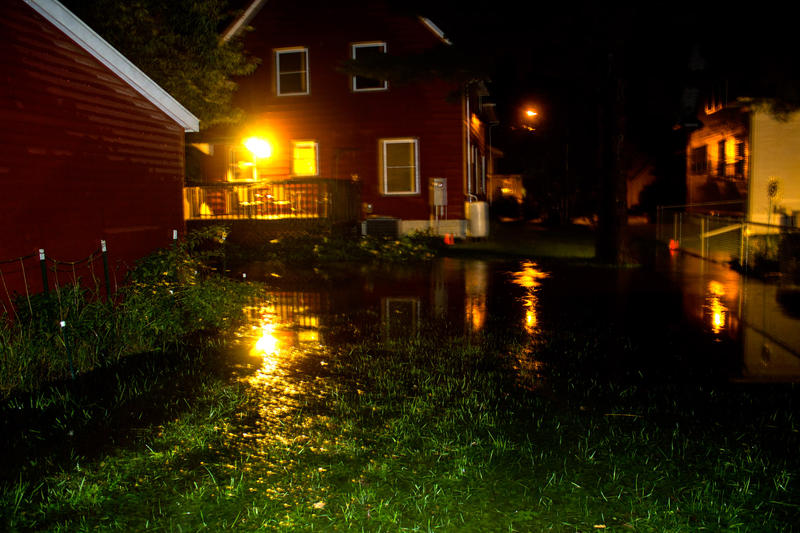 Water pools in a yard during heavy rains in Ames late Thursday night.