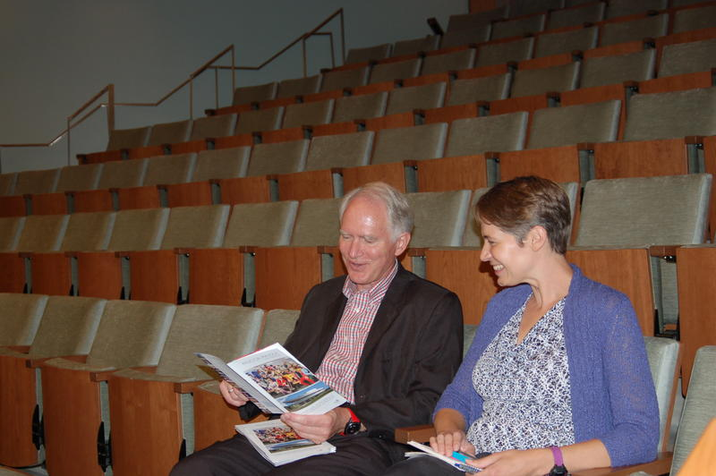 Executive Director Chuck Swanson and Charity Nebbe sitting in the main auditorium