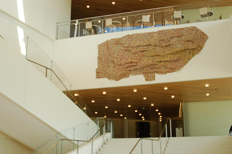 Art made of old beer bottles hanging above the grand staircase in the new Hancher auditorium