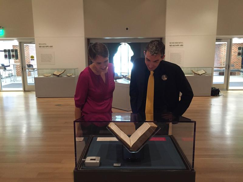 Charity Nebbe and Professor Adam Hooks look at the First Folio