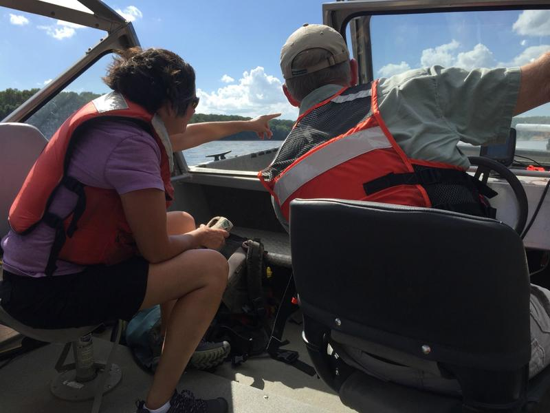 Geologist Carrie Elliott, left, and hydrologist Robb Jacobson study and measure earth sediment that drips into the Missouri River.