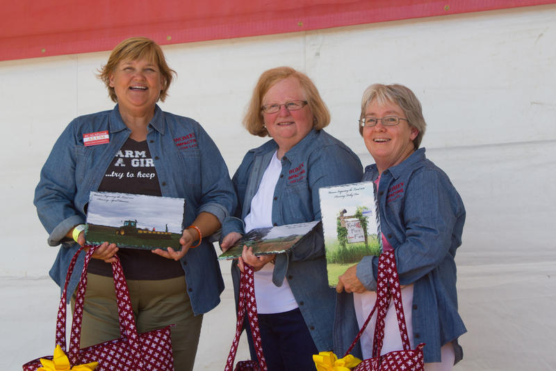 Three of ISU's Women Impacting the Land, April Hemmes, Cathy Ayers and Kathy Dice, receive their awards during the Farm Progress Show in Boone.