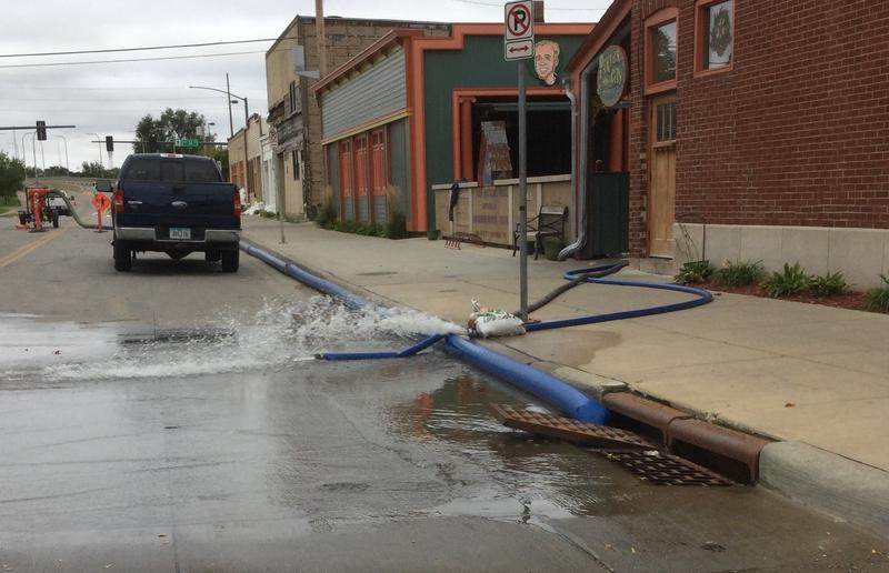 Temporary levees have held back floodwaters, but underground pressure has still forced water into many basements near the river.  The Parlor City Pub and Grill is pumping out some of the reported four feet of water in its basement.