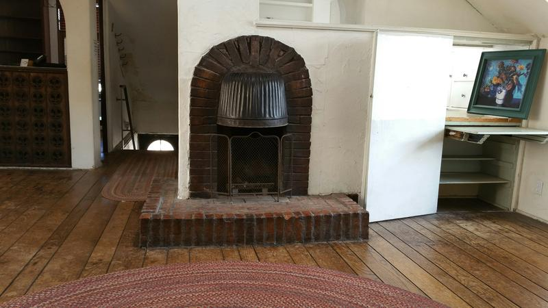 Wood liked to creatively use items he had on-hand, such as this overturned coal bin as a fireplace hood.