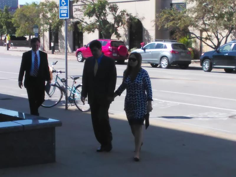 John Tate and his wife enter the federal courthouse in Des Moines on Tuesday, September 20.