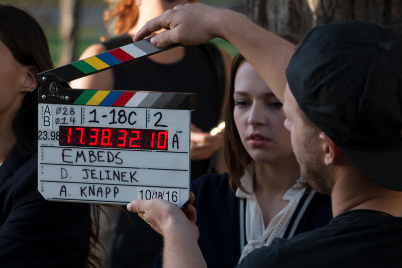 Right before a director yells action, information on a clapper board is recorded by cameras shooting a scene in Des Moines for the television series Embeds.