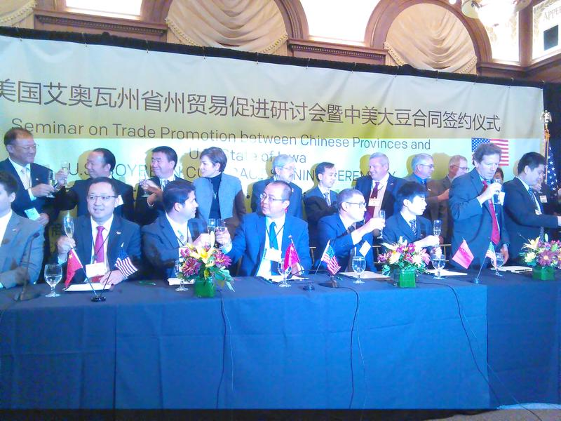 The Branstad Administration, Chinese officials, Chinese food company executives and U.S. soybean producers toast the signing of contracts totaling $2.1 billion at the World Food Prize building in Des Moines. (10/14/2016)