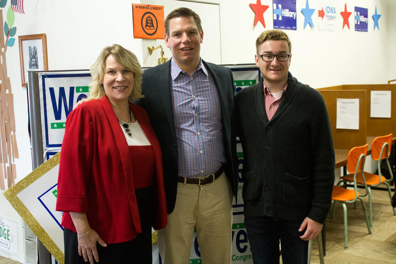 Candidate Kim Weaver and California Congressman Eric Swalwell met ISU College Democrats president Zach Rodgers during a campaign stop in Ames.