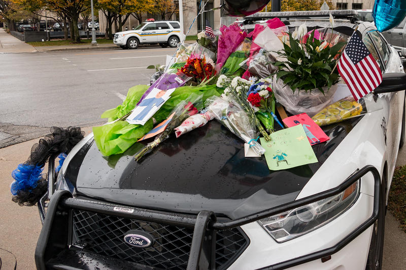 A police car parked outside Des Moines Police headquarters becomes a makeshift memorial
