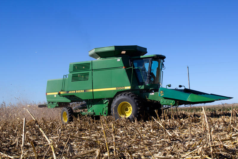 Edwin Johnson combines the last of a patch of corn he planted as part of a research trial.