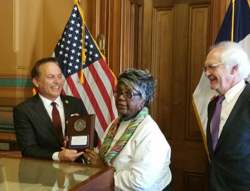Iowa Sec. of State Paul Pate presents Mildred Davis with the National Association of Secretaries of State Medallion Award.