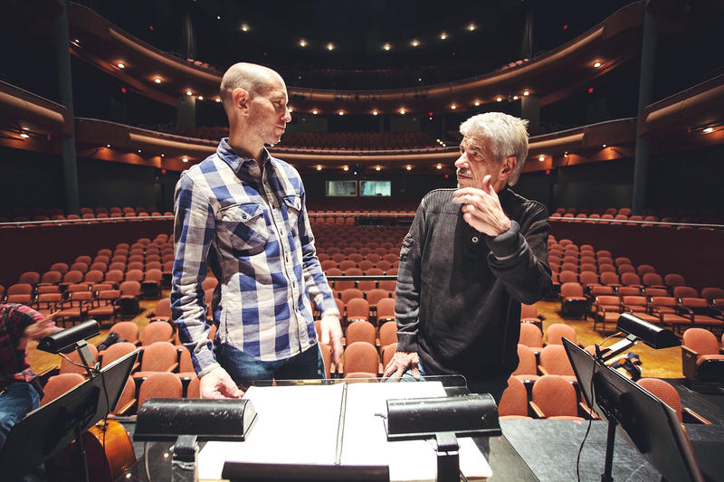 wcfsymphony Music Director Jason Weinberger discusses the show with artist Gary Kelley during the dress rehearsal