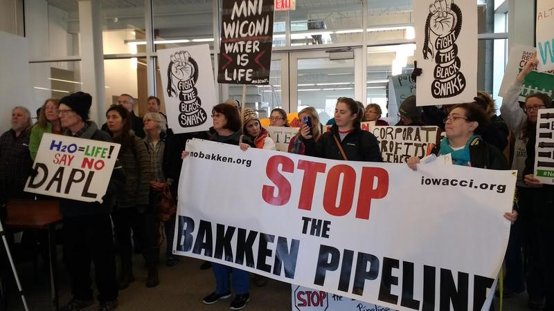Pipeline opponents gather in protest at the offices of the Iowa Utilites Board.