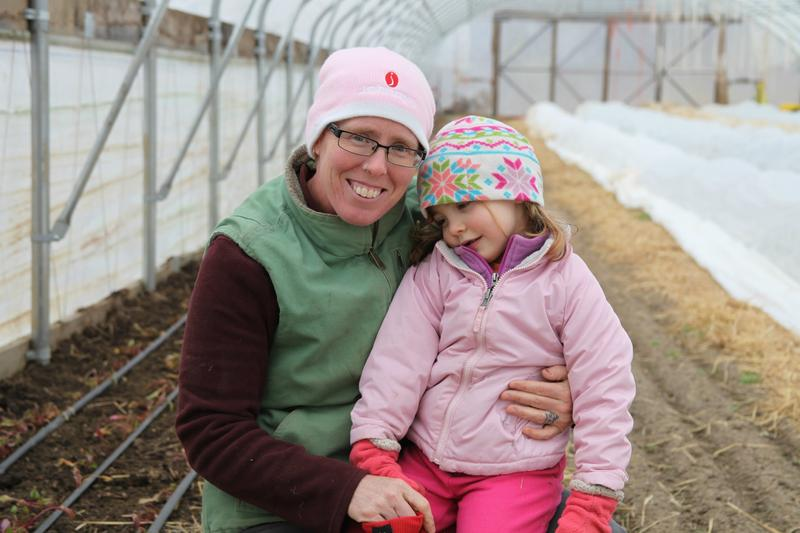 Graznak (with daughter Sylvia) had about $36,000 in student debt after graduate school that she wanted to pay down before starting her dream farm.