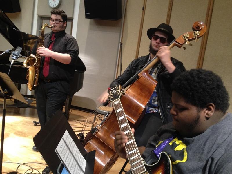 Sax player Abe Miller, bass player Clayton Ryan, and guitarist Kalim Manigault