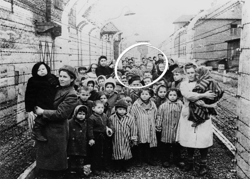 Soviet soldiers captured this image of Michael's grandmother Dora (center) carrying him out of Auschwitz in 1945.