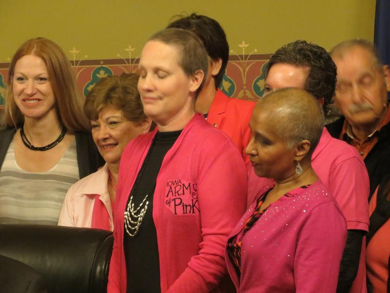 Breast cancer survivors at bill-signing