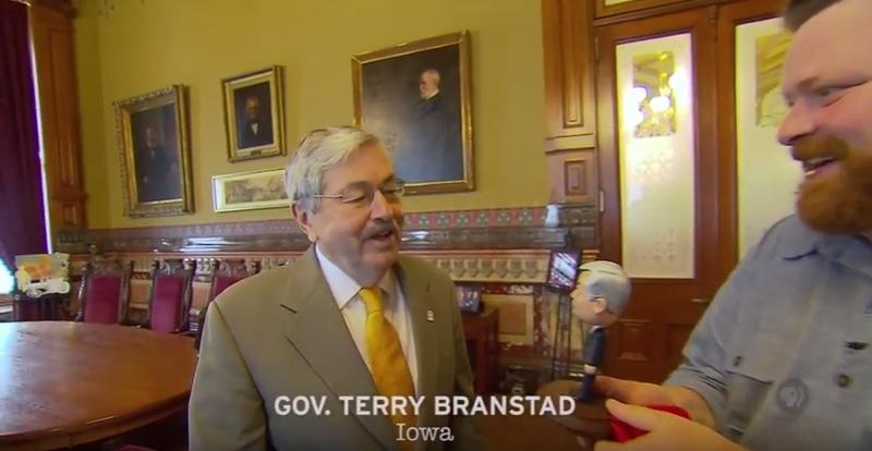 Bryan Guise unveils his bobblehead version of Iowa Gov. Terry Brandstad