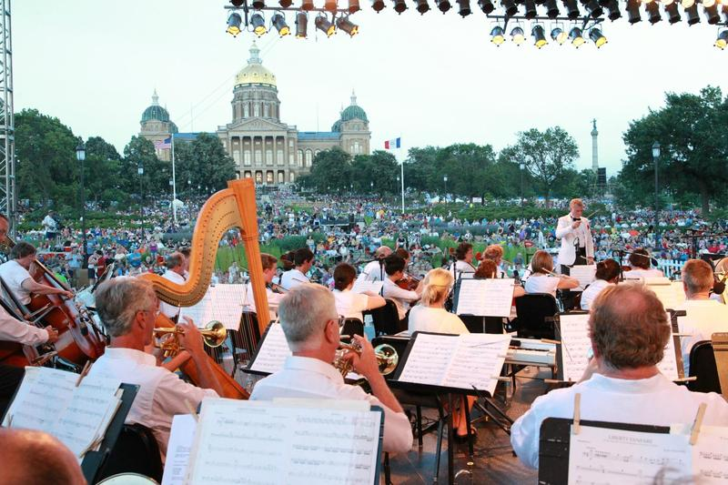 Maestro Joseph Giunta conducts the Des Moines Symphony on the West Terrace of the Iowa State Capitol.