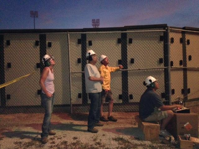 A team from J and M Displays watches as their fireworks display is fired.
