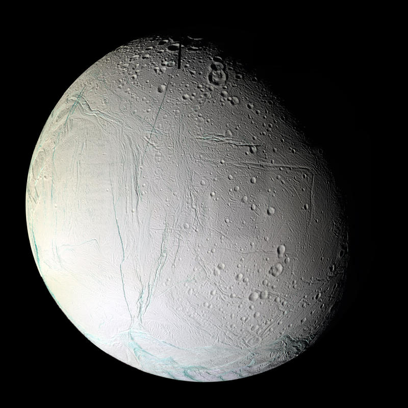 Saturn's 6th biggest moon Enceladus has coarse-grained water ice in the top layers of the lithosphere. This is the side facing away from the planet. Colors are altered in this composite image made with 75 shots taken by Cassini 3/9/2005.