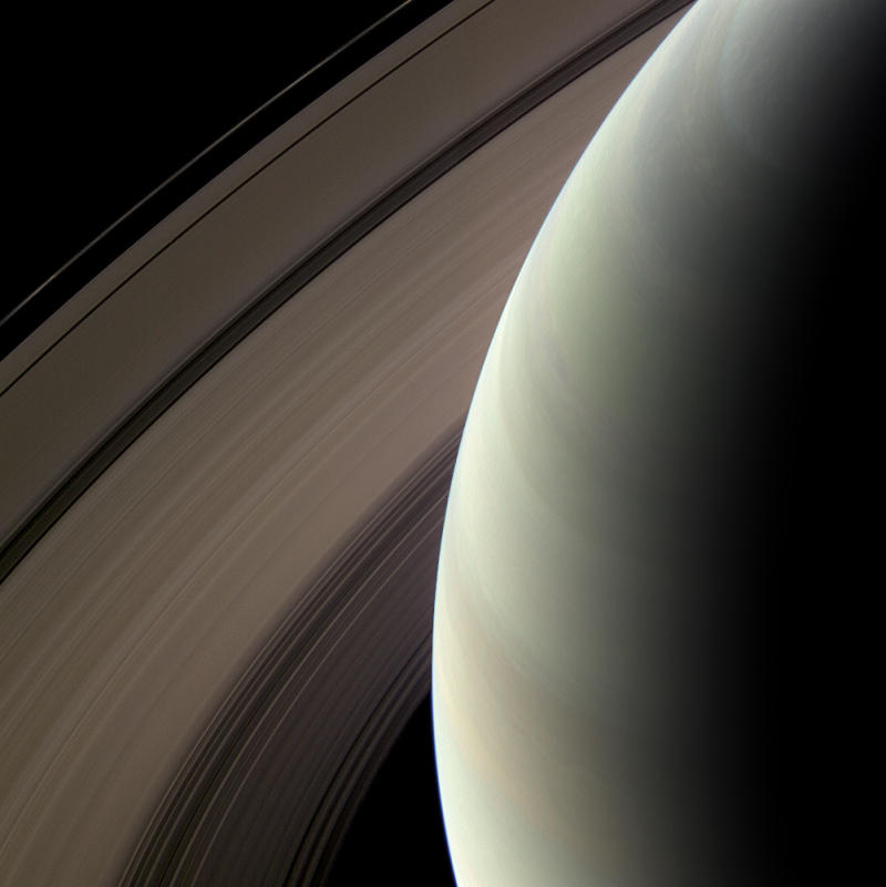 Composite image from Cassini as it is 538,000 miles from Saturn looking at the unilluminated side of the rings.  They are brightened to enhance visibility. Photos using red, green, and blue spectral filters represent a natural color view 2/24/2009.