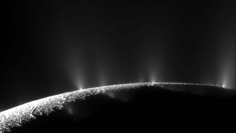 From the south pole of Enceladus, water and ice vapor spew from geysers.  The moon has at least 100.  A sea exists beneath the ice underlying the terrain. Composite picture from two images from Cassini's camera.