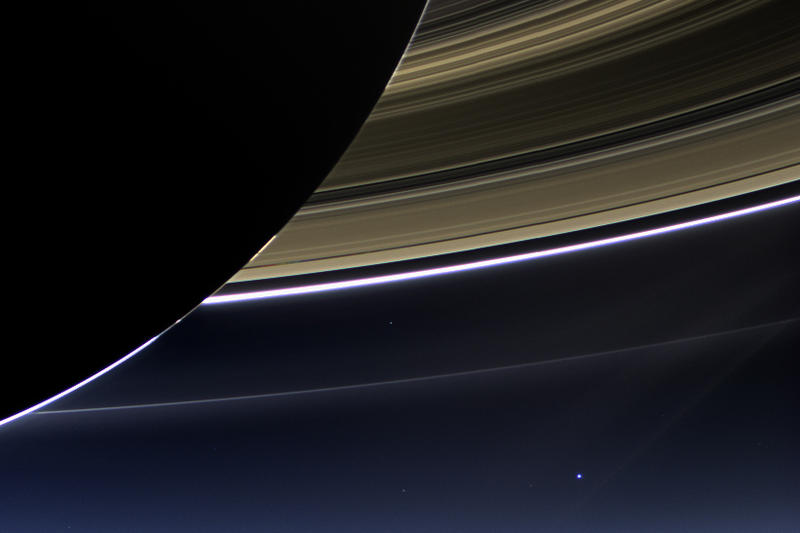 The blueish white dot is Earth, 898 million miles away from Saturn. Point of view from Saturn's night side. Part of a larger picture made from 323 images taken by Cassini 7/19/2013.  One of the few times Earth has been shot from the outer solar system.