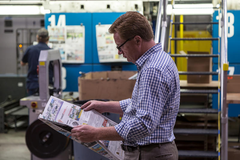 President of Iowa Information Publications and White Wolf Web Printers Jeff Wagner looks through a freshly printed newspaper at his large printing press in Sheldon, Iowa. Wagner's press prints about 80 newspapers a week. Wagner's company runs N'West Iowa