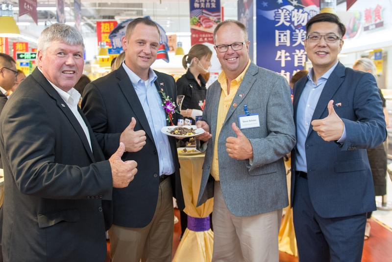 Mike Cline,  Iowa Cattlemen's Association; Matt Deppe,  Iowa Cattlemen's Association;  Steve Rehder, Iowa Beef Industry Council; and  Ming Liang, U.S. Meat Export Foundation  in Beijing celebrating the opening of markets to U.S. beef