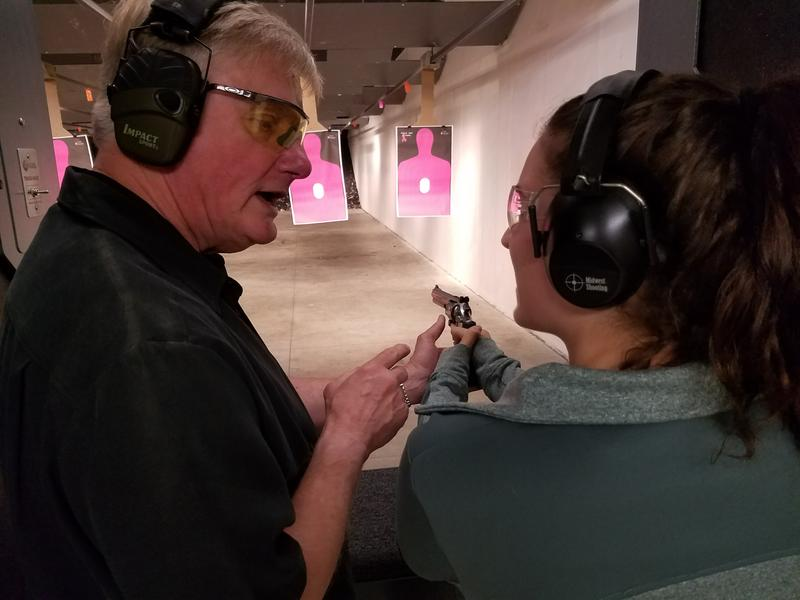 Instructor teaching proper firearm handling at Midwest Shooting Inc. in Hiawatha