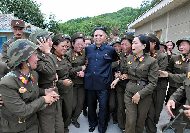 North Korean leader Kim Jong-un visits the Thrice Three-Revolution Red Flag Kamnamu Company under the Korean People's Army Unit 4302 in this undated picture released by the North's news agency in 2012